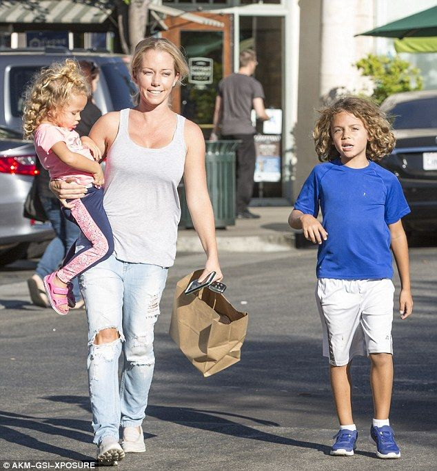 Mummy mode: Kendra Wilkinson took two-year-old daughter Alijah and son Hank, five, for a bite to eat at King's Fish House in the semi rural LA County district of Calabasas before dressing far more provocatively for Amber Rose's SlutWalk in Downtown Los Angeles