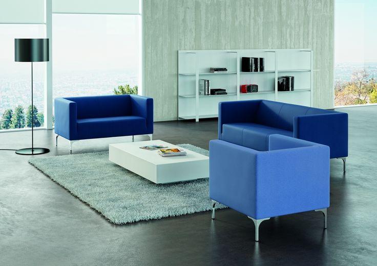 Arte blue armchairs. 2 or 3 seater sofa with alluminium feet. T05 melamine table. Half Moon floor lamp by Karboxx