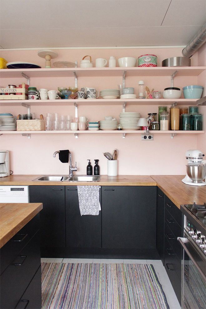 blush pink wood and black kitchen design with open shelves