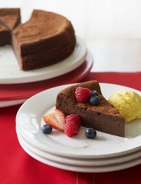 Chocolate brownie cake with berries and ice cream. A gorgeous gluten free bake for Easter.