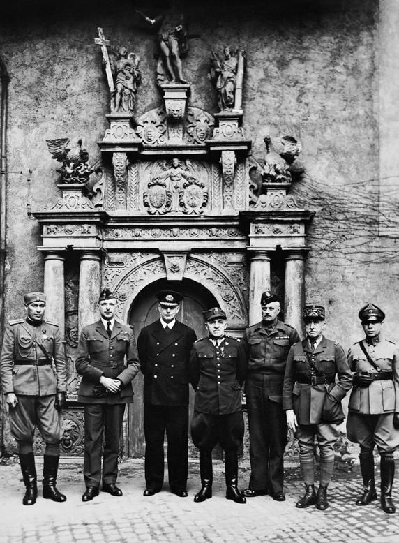 Senior officer POWs of the Oflag IVC in front of Colditz Castle chapel. L-to-R: Unidentified Yugoslavian Army Captain; Colonel de Smet, Belgian Army; Admiral Józef Unrug, Polish Navy; General Tadeusz Piskor, Polish Army; Colonel David Stayner, the Dorsetshire Regiment, British Army; General Le Bleu, French Army; Major E. Engles, Dutch Army.