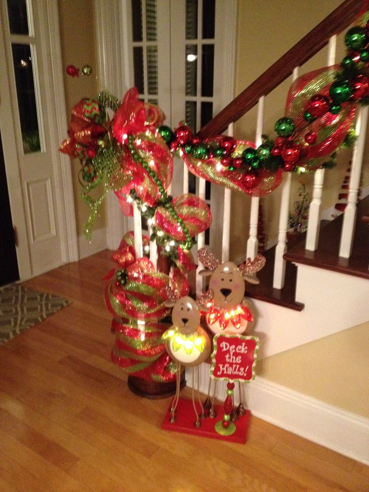 48 best images about christmas staircase decorating ideas for Christmas decorations stair rail