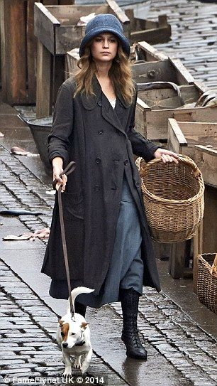Period drama: The actress wears 1920s style clothes and carries a basket and dog lead as s...