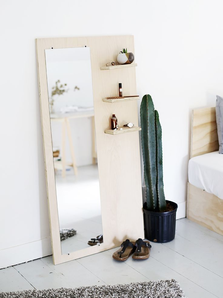 A DIY mirror complete with three useful shelves. Perfect for a walk in closet or dressing room