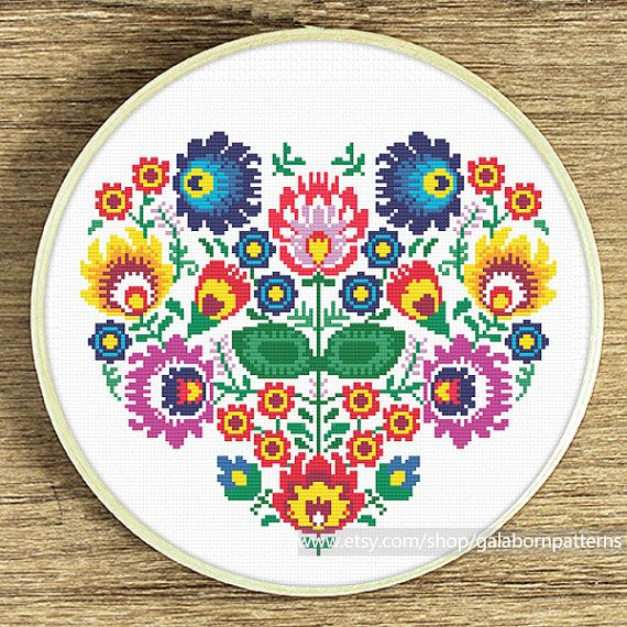 Title: Polish floral heart ornament Based on traditional Polish embroideries It is large size pattern  This PDF counted cross stitch pattern available for instant download.  Skill level: Beginner.  Pattern size (without white borders around): stitches: 112h x 130w ready design: 8.0h x 9.4w for 14-count fabric. You can frame it in 10 hoop, 10x10 frame (or bigger), or make the pillow cover  Floss: 13 DMC colors  14-count Aida fabric  This PDF pattern include: • image of finished design •…