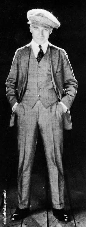 Here Charlie Chaplin is rockin 1920's mens fashion wear - 1922 Photographer is James Abbe