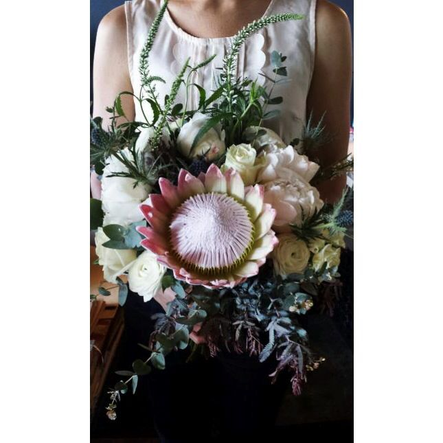 A wedding bouquet finished and on its way to the bride...
