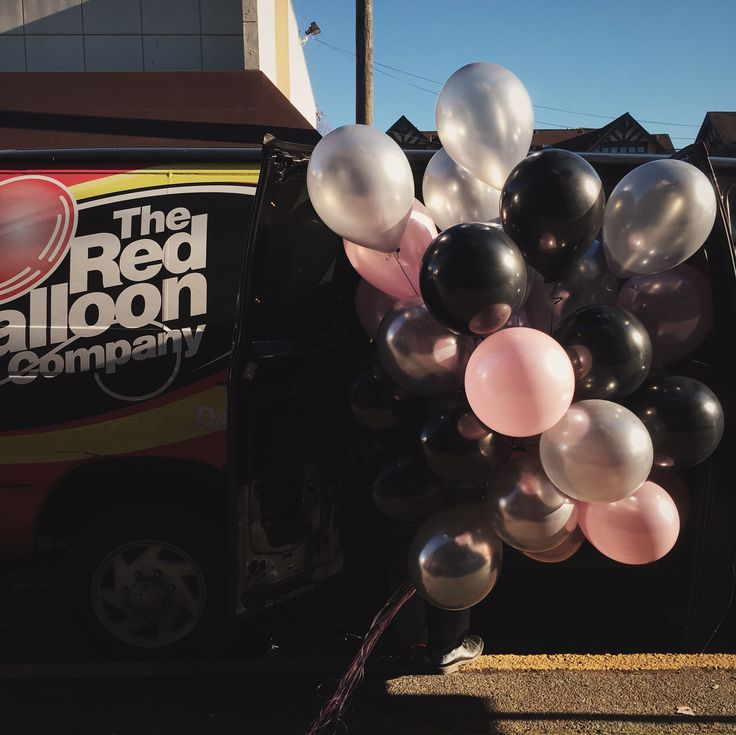 Pink, gray, and black latex balloons and balloon delivery by the Red Balloon Company