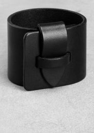 I love a leather cuff and I happen to own one exactly like this - bought from & Other Stories in London.