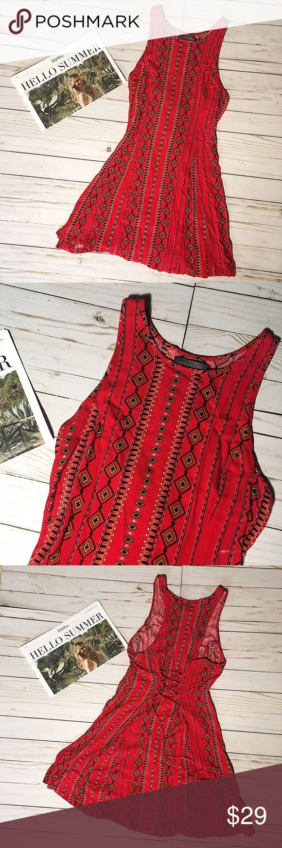 "Kendall & Kylie Red Aztec Print Dress Size S Kendall & Kylie dress. Excellent used condition no signs of wear- no holes or stains. You can tie the dress at the back like a corset. Has a small gold plate on the back of the neck with ""Kendall & Kylie"" engraved on it. Dress measures approximately 27in in length from top of shoulder to hem. Kendall & Kylie Dresses"