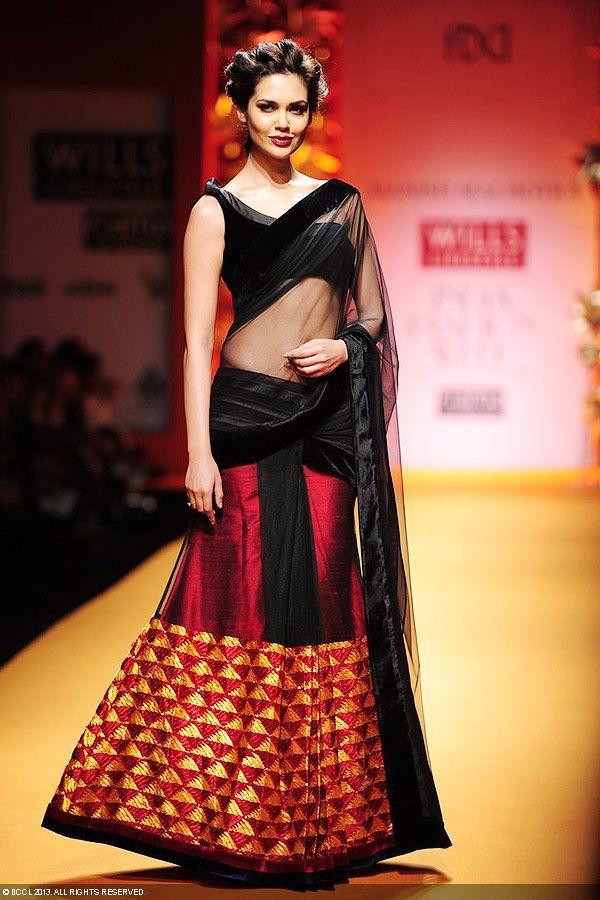The gorgeous Esha Gupta showcases a creation by designer Manish Malhotra on Day 3 of the Wills Lifestyle India Fashion Week (WIFW) 2013, held in Delhi.