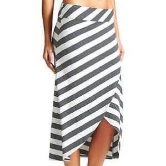 Athleta Striped Tulip Skirt Charcoal grey and bright white stripes. Form flattering and super comfortable; medium-weight, 92% rayon/8% spandex jersey knit. Wide elastic waistband fits at the hips or waist, cross-over tulip style for more freedom of movement, and flirty hint of leg; knee length in front to mid-calf in back. Machine wash cold gentle cycle, tumble dry low. Athleta Skirts High Low