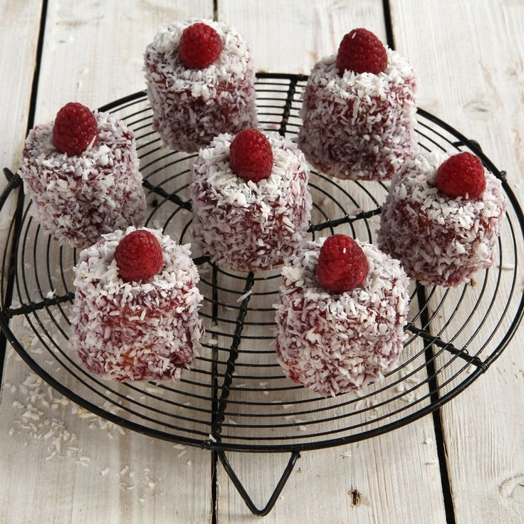 English coconut madeleines recipe | BakingMad... These adorable little cakes are a great addition to any afternoon tea. Fluffy vanilla sponge, raspberry jam and coated in coconut what more could you want...