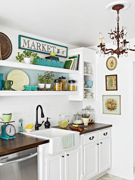 Clever KITCHEN arrangement for cottage or contemporary home. RUSTED CHANDELIER is a witty piece taken from tradition, WHITE DECOR and OPEN SHELVES are from the now finished with fun, eclectic VINTAGE ACCESSORIES. Works because nothing vies for attention more than anything else - balance!