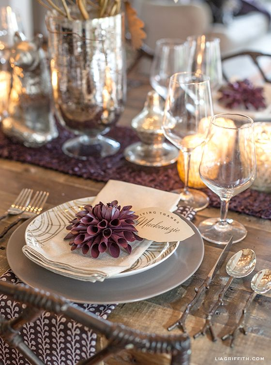 Lia Griffith's Thanksgiving table in plum + metallics: SOURCES: Latte Dinner Plates, Faux Bois Salad Plates, Pale Gold Napkins, Berry Print Napkins, Twig Flatware, Silver Fox, Wine Glasses, Mercury Glass Candle Holders, Dining Table from West Elm   Pumpkin Bakers, Mercury Glass Vase from World Market   DIY Thankful Tree Centerpiece + Paper Dahlias + Gold Leaf Place Card (free printable templates)