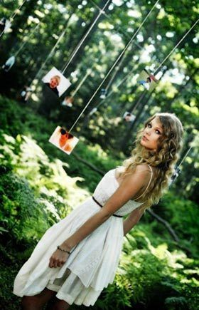 Idea from Taylor Swift's 'Mine' video: hanging photos of the bride and groom and their story. Definitely outside, like this pic.  Maybe before the reception while wedding party is taking pictures.