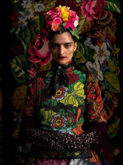not sure if they were going for this but she looks like Freda Kahlo, no?