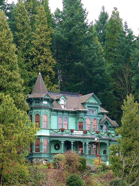 """Shelton-McMurphey-Johnson House,"" by Jay Boal, via Flickr -- ""The Shelton-McMurphey-Johnson House in Eugene, Oregon. This is a Victorian mansion dating from 1882."" -- I love everything about this, especially the colors (the turquoise and coral are so striking against all the green) and the Christmas decorations. Another view here: http://www.flickr.com/photos/jakeslagle/232922309/in/faves-craftyintentions/"