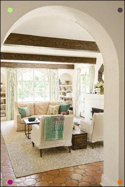 mediterranean living room with wood ceiling beams and arched doorway rh pinterest com