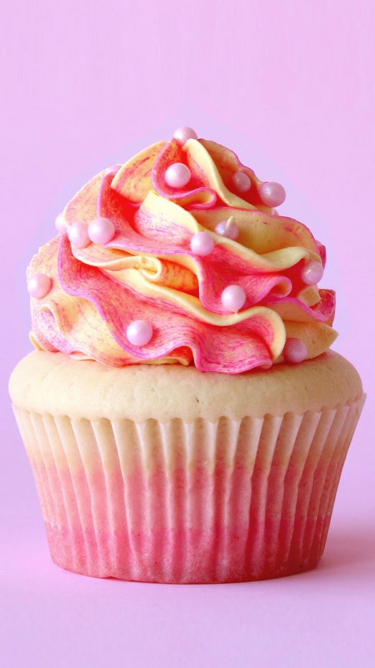 Recipe with video instructions: Rosé and rose water makes these Rosé Champagne Cupcakes to die for. Ingredients: 429g (2 1/2 cups) all-purpose flour, 3 tsp baking powder, 265g (1 1/4 cups) caster (superfine) sugar, 1/2 tsp salt , 375ml (1 1/2 cups) of rosé champagne, 125ml vegetable oil, 125g butter, 125g butter 2 tbsp Greek yogurt (can substitute with sour cream), 1 tsp vanilla extract, 2 large eggs , 2 tbsp rose water essence for batter, 2 tbsp rose water essence for frosting, Soft sugar…