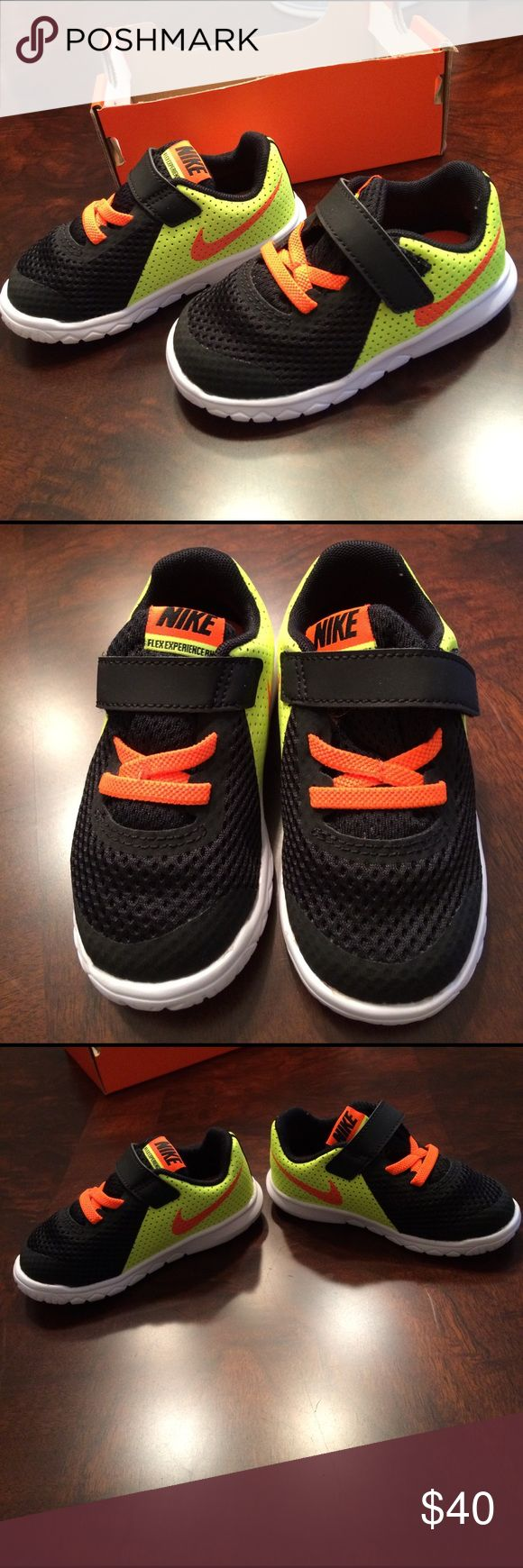 NIB! Baby boys Nike shoes, 7. NIB neon yellow, neon orange and black, baby boys Nike shoes, so cute! Size, 7. Nike Shoes Sneakers