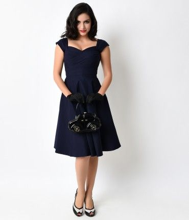 Drive all the boys crazy with this 1950s-inspired Mad Style Navy Cap Sleeve Swing Dress by Stop Staring! With a classy s...Price - $172.00-BFp9nMbr