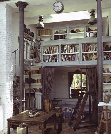 Hmm.. bookshelves in place of railings in the loft?