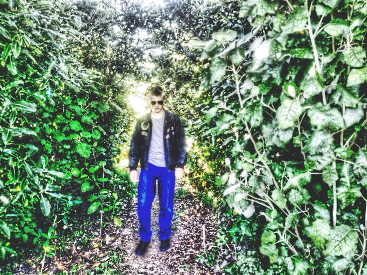 A heavily edited photo of Ethan walking down a path to one tree hill