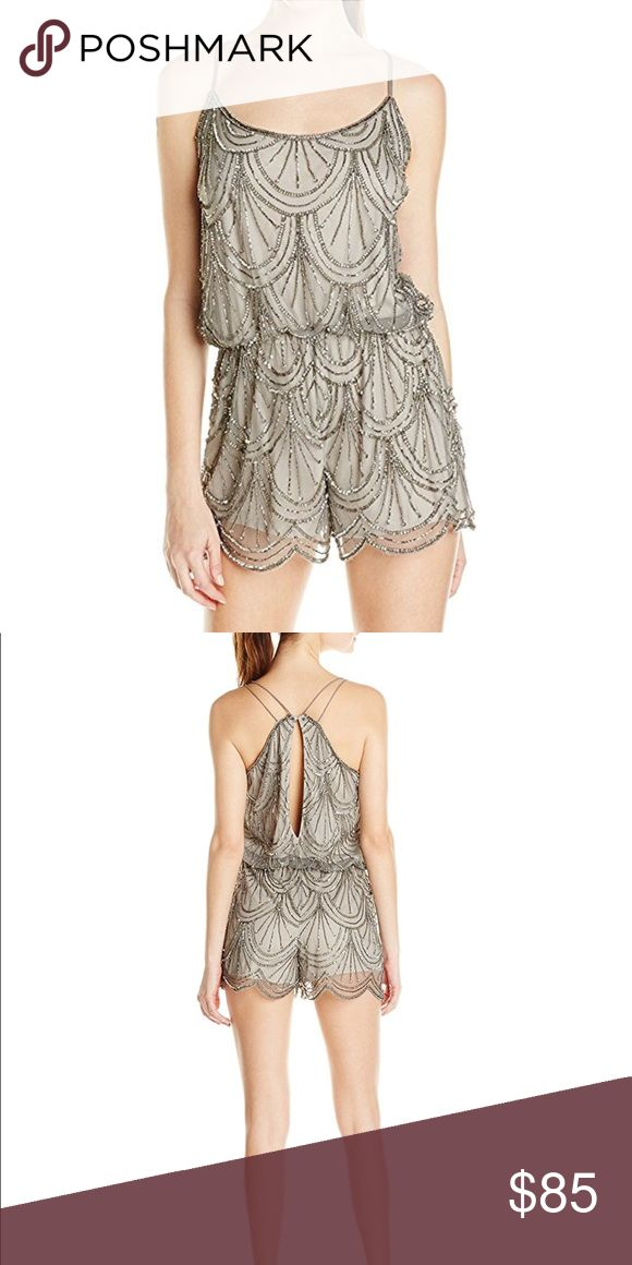Silver Beaded Spaghetti Straps Romper - sz Small Description Angie women's silver beaded spaghetti strap cocktail party romper  Shell: 100% Nylon; Lining: 100% Polyester Imported Dry Clean Only Hand beaded Fully lined Angie Shorts