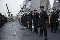 Sailors aboard the Arleigh Burke-class guided-missile destroyer USS Truxtun (DDG 103) man the rails.