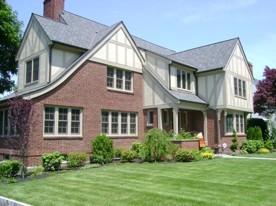 Remodeled exterior of tudor style home tudor exteriors for Tudor siding