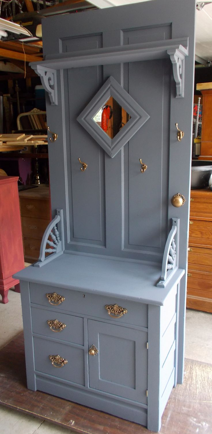Old farm door and vintage ash commode .. Fasten together .. added a coat of Colonial blue paint, a mirror, shelf, coat hooks and drawer hardware and it's re-purposed into an awesome country hall coat tree ...