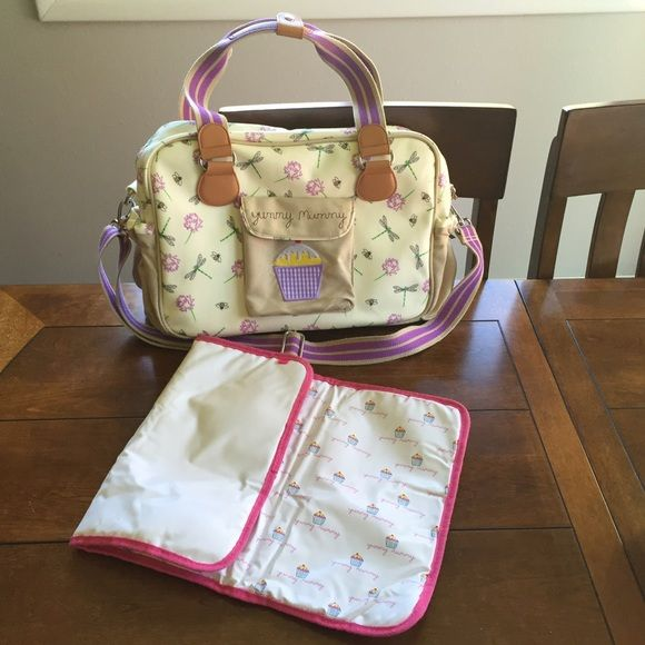 Dragonfly pink lining diaper bag Adorable, well crafted diaper bag. Two canvas elasticated side pockets, adjustable shoulder strap that is long enough to fit over any stroller handle bars. Internal Features: 2x insulated bottle holders, 2x diaper pockets, pen holder, key fob, mirror, phone pocket, small zip pocket. 38(L) x 14(W) x 28(H) cm. Both side canvas pockets have some stains, otherwise in great condition. Includes padded diaper changing mat. Pink lining Accessories Bags