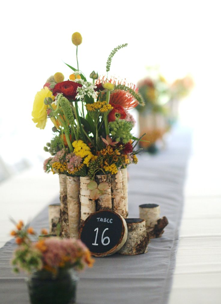 Orange yellow and red centerpiece in birch bark container