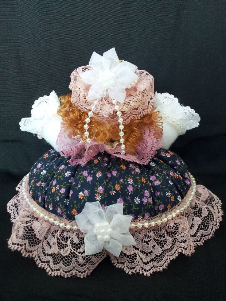 The May Pole Lady. Back view. Collectable Pin Cushion Doll. Material: Cotton & Lace. $25.00CAD + S/H if applicable. $0.00 Tax. Please contact Nola at: http://www.facebook.com/elegantcreationsbynola for purchase