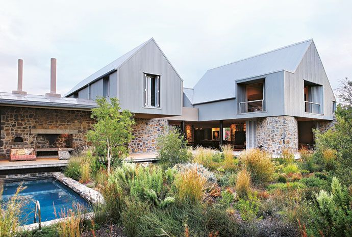 The house consists of four barn-like structures linked together with a series ofstone walls.