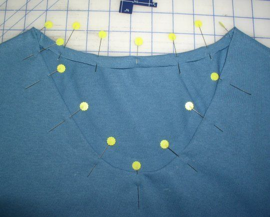 Changing the neckline of a shirt without using a collar band...perfect for my next project!