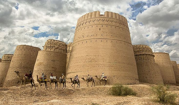 """Tahsin Shah, a Pakistani police chief, drove 500 kilometers pursuing the """"romance and decaying glory"""" of the ninth century Derawar Fort. He captured a camel caravan strung along its bastions, a scene that could have taken place 1,000 years ago, for tenth place."""