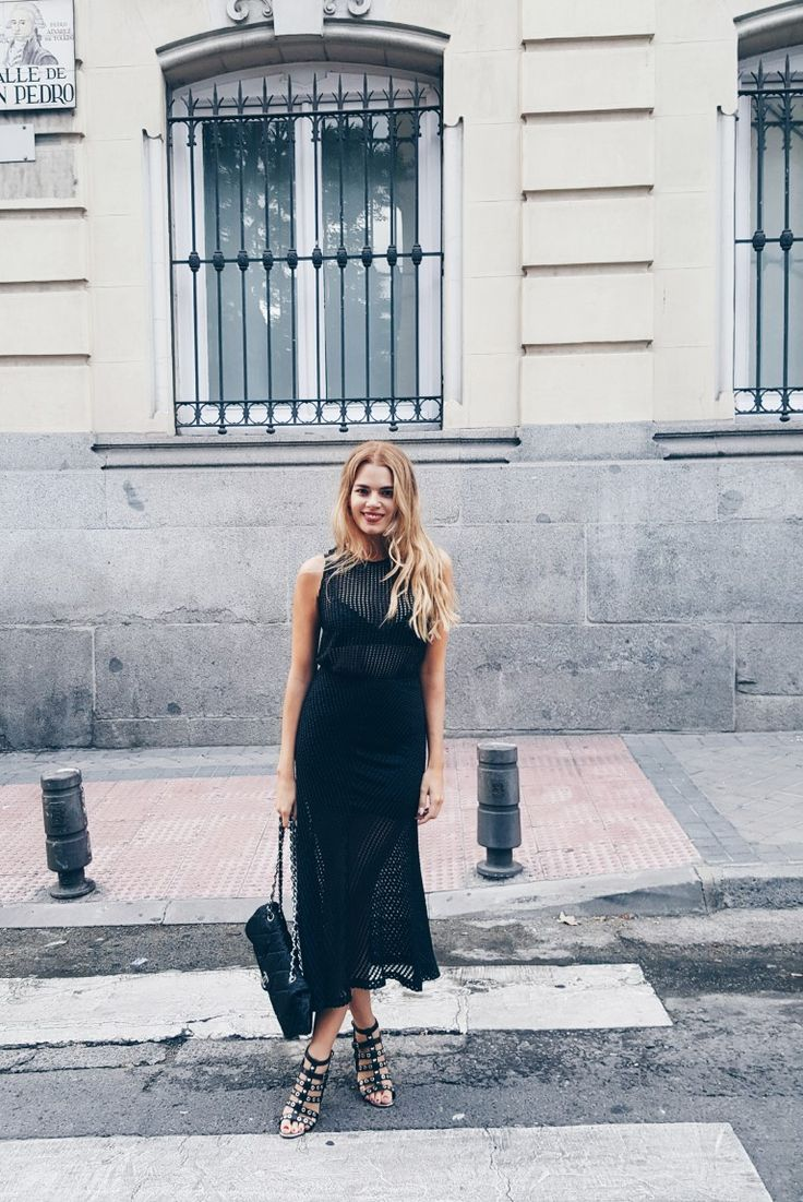 Miriam Perez is rocking an edgy, alternative all black style here, in a bralet and skirt worn underneath a sexy mesh dress. Pair this outfit with strappy gladiator sandals and a classic quilted handbag to steal Miriam's style. Skirt/Top: Sfera, Sandals: Topshop, Bag: Chanel.