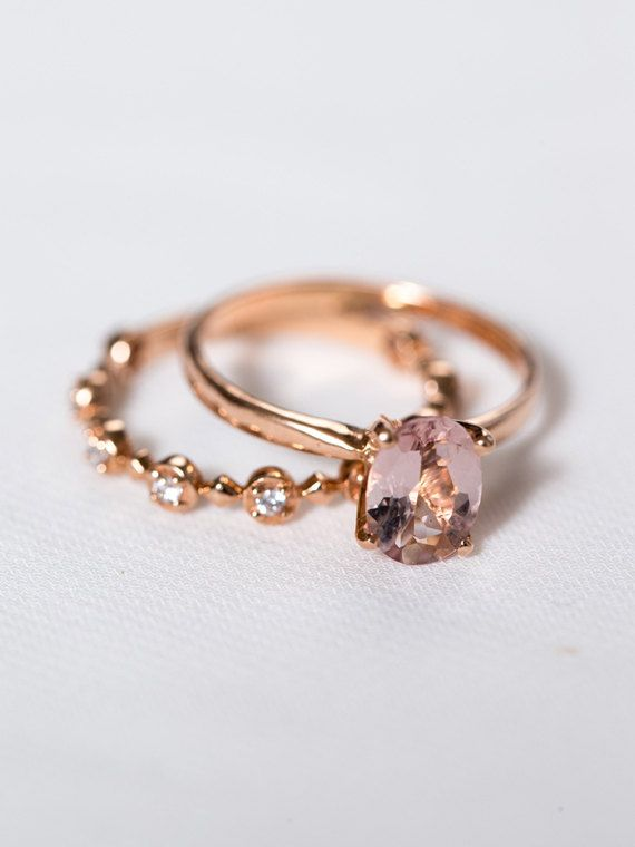 The Geneviève Ring  A flawlessly simple oval blush morganite gem, set atop a tapered 14k gold band. This solitaire engagement ring effortlessly
