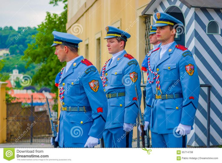 prague-czech-republic-august-palace-guards-duty-wearing-their-distinctive-blue-uniforms-white-striped-booth-weapon-visible-65714798.jpg (1300×954)