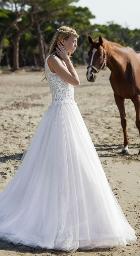 Beautiful sleeveless lace bodice wedding dress with tulle A-line skirt; Featured Dress: Christos Costarellos