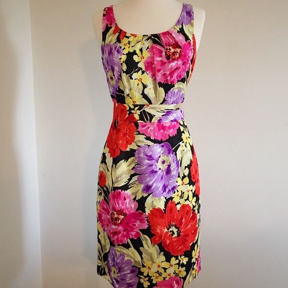 Floral Print Fitted Dress Shell: 67% Rayon, 33% Linen. Lining: %100 Acetate. A fun, floral, eye-catching dress! Perfect for any occasion. Great with nude or black heels. Pretty pleating at the neckline. Hits right at the knee. Just a statement pair of earrings and a bracelet and your set! Yellow, khaki, bright pink, red, and purple flowers on a black background. Worn once to dinner and a film festival. Banana Republic Dresses
