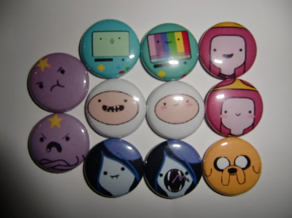 Adventure Time with Fin and Jake 1 inch Button Set      11 1 Inch buttons inspired from the show Adventure Time with Fin and Jake.  Going Left to Right:    Space Lumpy Princess upset, Beemo, Rainbow Beemo, Princess Bubblegum big smile,    Space Lumpy Princess crossed arms, Fin big smile, Fin blushing, Princess Bubblegum Blushing,     Marceline, Marceline hissing, Jake    $2.75 shipping is First Class with a bubble envelope.  Ships from United States    SHIP TOCOSTWITH ANOTHER ITEM  United…