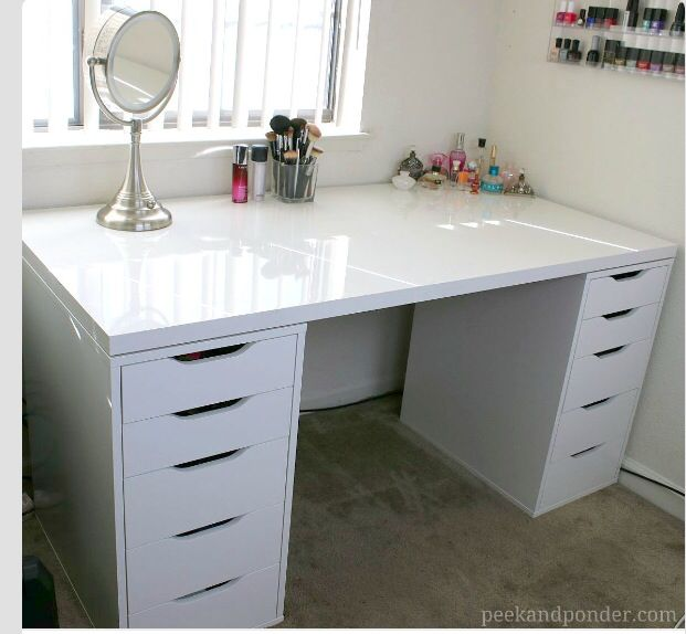 Smaller tabletops ($26 at Ikea) with 1-2 of these drawers ($79 each)