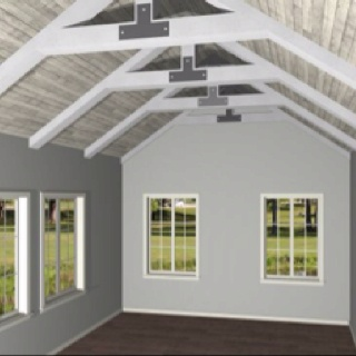 Exposed vaulted trusses visually enlarge the space and of course...gray and white love