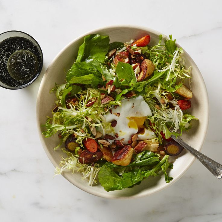 This salad was inspired by the classic French bistro salad, in which sturdy winter greens are laced with crisp lardons of bacon and a silky poached egg. We'll never begrudge you a bit of bacon, but here vegetables are roasted to give the salad a leaner form of texture, flavor, and color.
