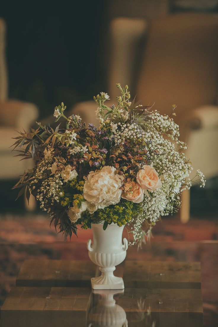 Old fashioned combination of Baby's breath gypsophila, peonies and roses. Photo: Jake Thomas Photography