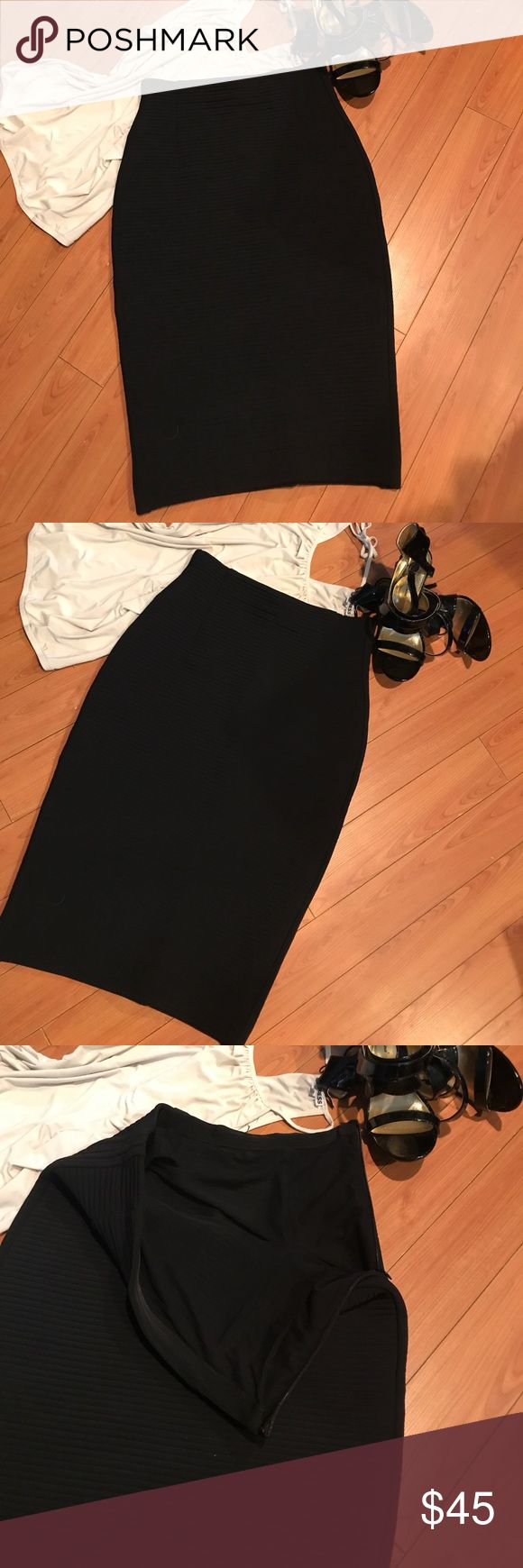 Beautiful Black BodyCon Skirt This is a beautiful bodycon skirt. The designer and size tags are gone but measurements indicate a 10-12. This came from a lot of mannequin samples and returns from Nordstrom. I am 99.9% sure this is from Parker, but no tags. So price reflects. It's a beautifully made and cut skirt of excellent quality. See photos for measurements. made in NYC and has tons of stretch. It's a dense fabric and is fully lined. This would not be a lightweight summer option. Parker…