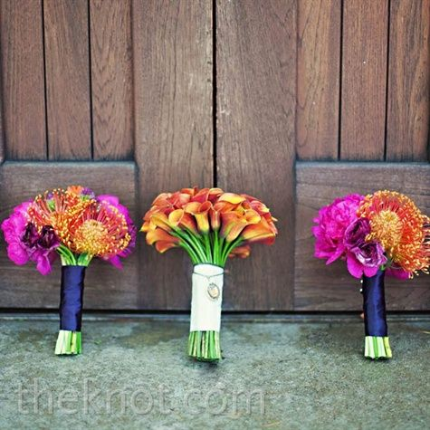 A tight bouquet of mini orange calla lilies for the bride, the girls held fuchsia tulips, dahlias, gloriosa lilies and bullet alliums.